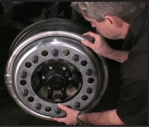 Installing Centramatic wheel balancers on a front wheel
